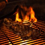 Our steaks are grilled over hot coals