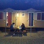 Family having dinner outside of room.