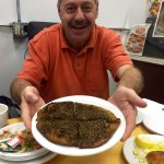 Homemade knafeh, tea, baba holding zaatar, roasted cauliflower, hummus and baba ghannouj :)