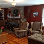 Beautiful lounge area just off the dining area. Warm cozy wood stove fireplace to sit beside.