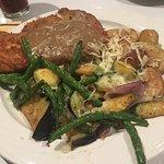German dinner. Chicken and pork schnitzel
