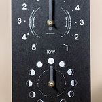 A selection of tide clocks available