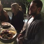 Friends eating outside at El Huerto