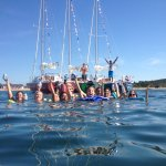 Group of friends sailing and swimming in Montauk. Don't drop the beer!