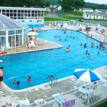 Outdoor pool with diving, kiddie pool, enclosed sports pool and hot tub