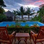 The sun settin gover the pool.