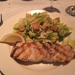 Chilean sea bass with Caesar salad on the side