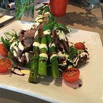 Rib Fillet strips with Asparagus on a Rocket Salad