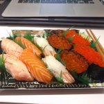 A set of 5 nigiri: salmon, seared salmon x2, tobiko with caviar x2