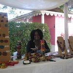 A jewellery maker at the craft fair in the Botanical Gardens