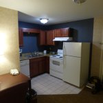 Fully equipped kitchen with dishwasher, dishes, microwave