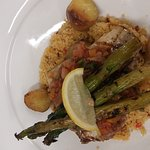 Grilled swordfish with Mediterranean cous cous, grilled asparagus, roasted new pots and pineappl