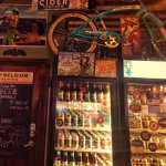 Scene inside with coolers and old bike with other paraphernalia