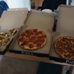 From left to right: Vegetarian Deluxe, Pepperoni, & Beef Pizza