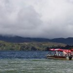 Playa Blanca. Here you can rent boats to travel the lake, camp, and many other things