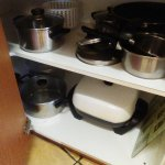 Pots and pans dirty and just thrown in the cupboard