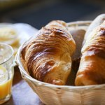 Breakfast time!  Fresh croissants with orange juice.