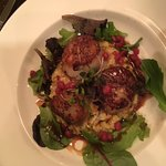 Seared scallops, garlic cheese grits with pomegranate molasses