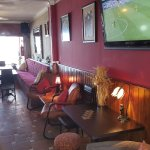 4 large screens situated through the bar