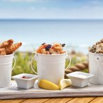 "Try our ""Boathouse Buckets"" - fresh beer battered fish, chilli prawns & spiced calamari"