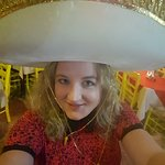 Wearing the birthday hat!