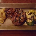 Steak with garlic mashed potatoes and grilled zuchinni
