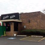 front of & parking lot entrance to Little Villa Restaurant