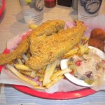 Two whole catfish with fries, hush puppies and cajun cabbage