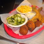 Catfish fillets with mac & cheese, hush puppies and cucumbers