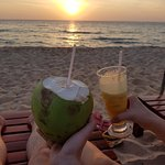 sunset from the beach with fresh juice