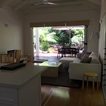 View from the kitchen through the loungeroom to the outside deck