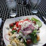 Peasant Salad with organic greens, grape tomatoes, artichokes, and kalamata olives.