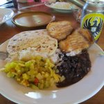 Lunch of fish, beans, rice, vegetables, and cerveza