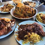 Nasi Kandar (Rice with mixed curries, fried chicken, beef in dark brown gravy, squid curry)