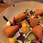 Breaded cheese with salad and balsamic dressing