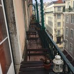View of the other rooms' balconies from our room (street below)