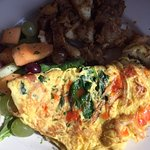 Florentine omelet and cajun potatoes. Potatoes are not that dark, there was a shadow on them.