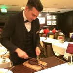 Carving the steak at our table