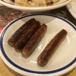 Burnt and old sausage links and dark salty oatmeal