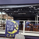 WITCHES BREW street level signage and outside deck are