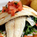 Seabass  on wilted greens