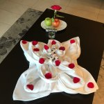 Towel flower with rose petals and chocolates plus fresh fruit