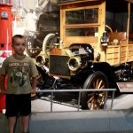Grandson viewing old cars