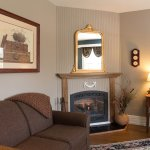 Comfortable seating and a cozy fire in the Blue Ridge room
