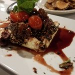 feta grilled with grilled tomato, fig preserve and oiives