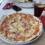 Pollo Pizza at Capricciosa Restaurant. Ingredients: Mozzarella cheese, ham, chicken, corn