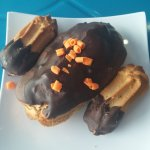 Eclair with chocolate cream filling along with dark chocolate butter cookies