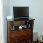 Small TV and coffee maker. No fridge.
