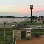 View from upstairs end of building: NOT from any of the rooms. Lake Conroe across st.