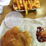 Crinkle cut fries and a bulging large BBQ sandwich (no plates or utensils)